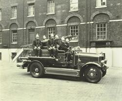 Fire engine with motor pumps.