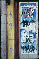 A torn Flying Pickets poster over a poster of the band Madness